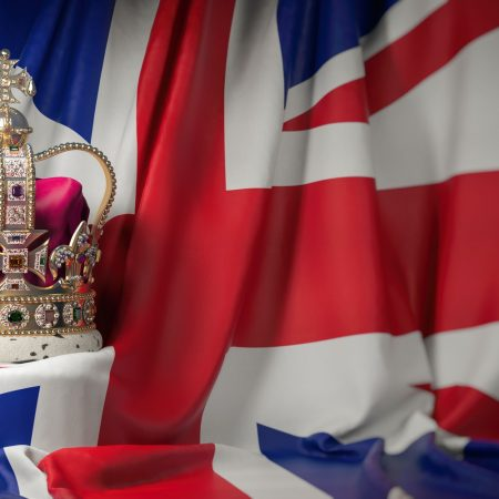 Royal golden crown with jewels on british flag. Symbols of UK U